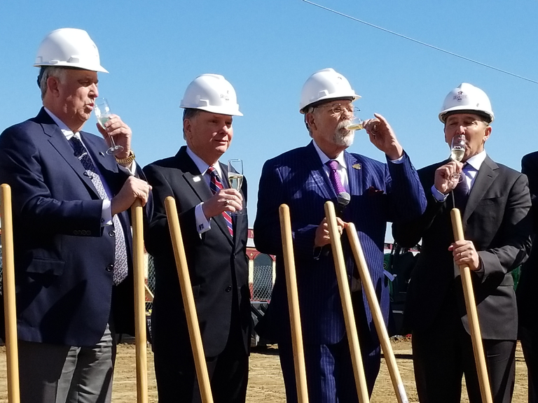 From left, Scott Mahaffey, chairman of the board for Trinity Metro; Paul Ballard, president and CEO of Trinity Metro; Grapevine Mayor William D. Tate; and Paul Coury, CEO of Coury Hospitality, share a toast Wednesday, March 7, at the groundbreaking for Grapevine Main. Nicholas Sakelaris Special to the Star-Telegram